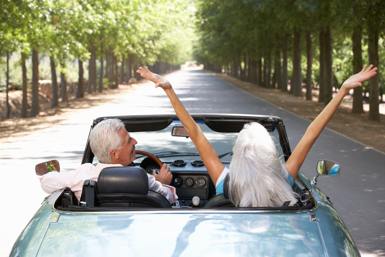 bigstock-Senior-couple-in-sports-car-23188265