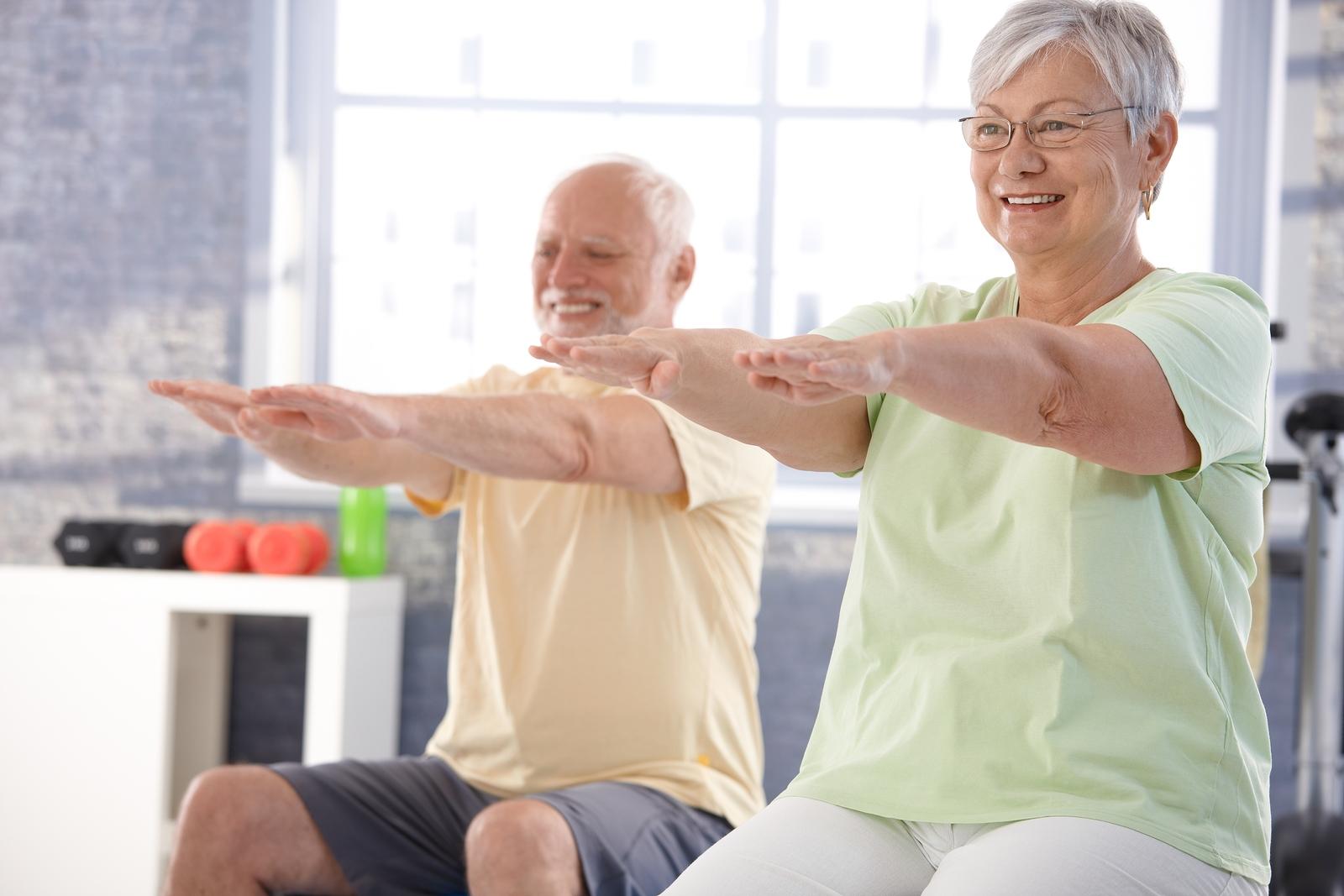 bigstock-Mature-people-exercising-happi-32925062